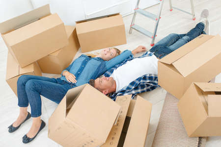 house exchange: Laying amongst packing boxes Stock Photo