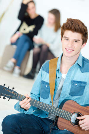 boy playing guitar: Teenage boy playing guitar