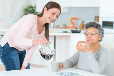 drink coffee: Pouring a coffee for her grandma