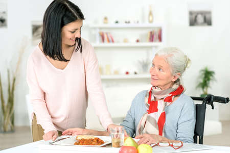 senior female: Care worker Stock Photo