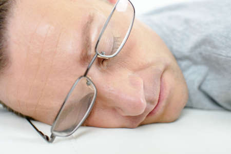 wearing spectacles: Man asleep wearing spectacles