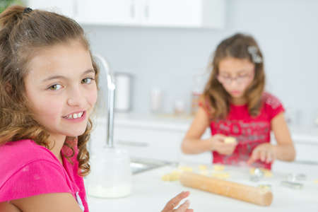 preparation: Sisters baking in the kitchen Stock Photo