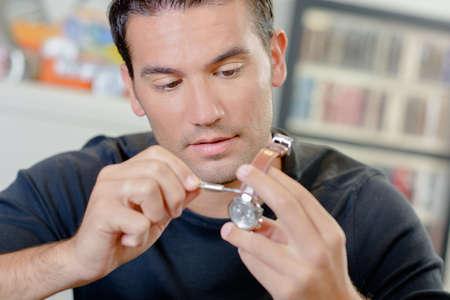 pricey: Patient man repairing a watch