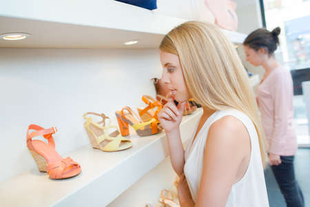 football shoes: Woman looking at shoes in a shop