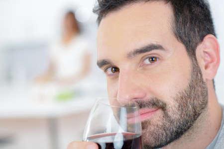 degustating: Man enjoying a glass of red wine