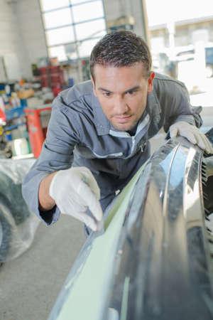 burnish: Mechanic working on the body work