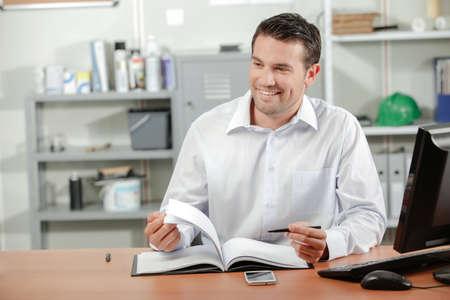 flicking: Man at office desk