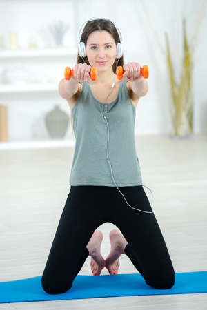 working woman: Woman working out at home