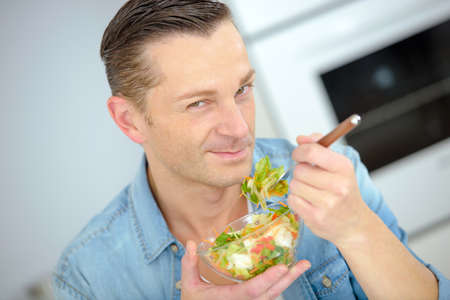 unmarried: Man eating a healthy salad Stock Photo