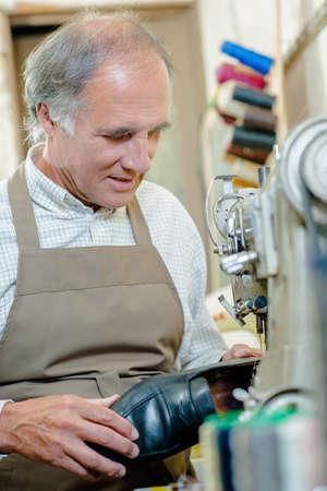 cobbler: Cobbler in his workshop Stock Photo