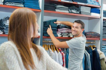 clothes shop: Couple in a clothes shop