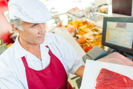 congenial: Butcher at work Stock Photo