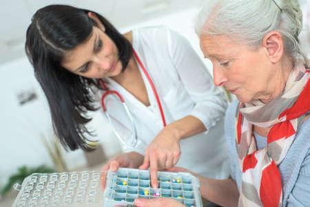 Pills arranger for each day Stock Photo
