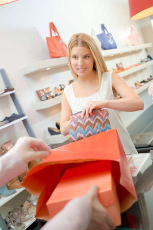 checkout: Lady at checkout buying shoes Stock Photo
