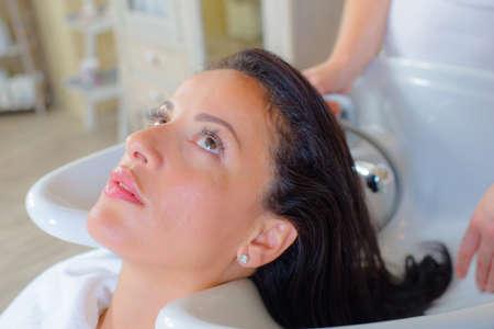 hair saloon: Hairdresser washing a womans hair