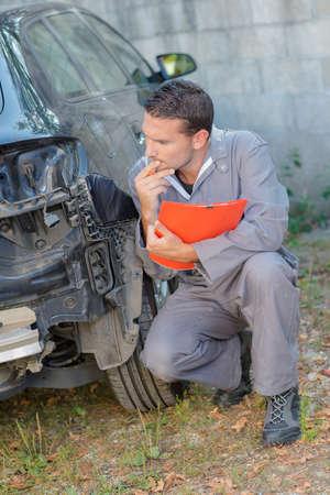 assessing: Mechanic assessing car