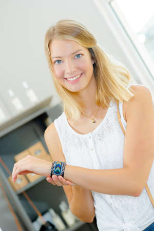 accessorize: Lady showing bracelet