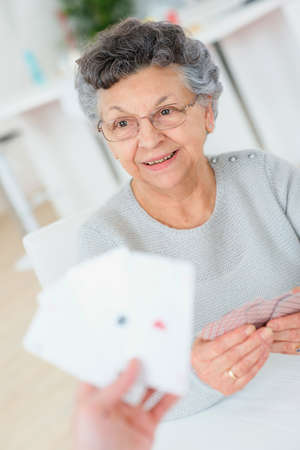 senior adults: Old lady playing cards