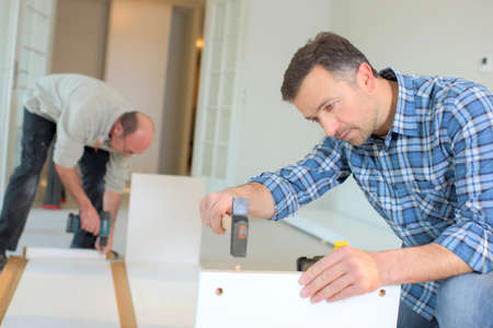 finishing: Putting together flap pack furniture Stock Photo