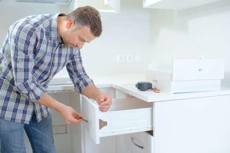 furniture: Man assembling furniture Stock Photo