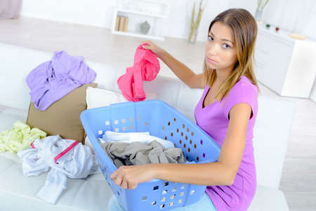 sorting out: Woman sorting out the laundry
