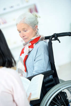 guidance: Helping senior woman to read