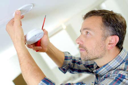 security alarm: Installation of a smoke alarm Stock Photo