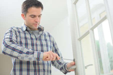 joiner: Handyman fitting a new door