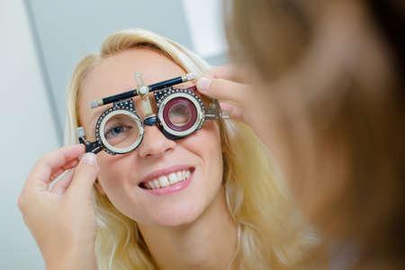 eye test: Woman having an eye test Stock Photo