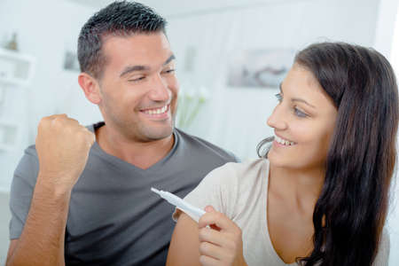 Couple reading pregnancy test result Standard-Bild