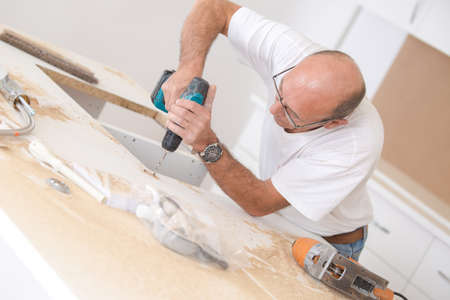 cordless: Handyman building some furniture Stock Photo