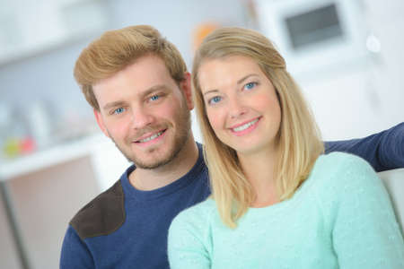 first home: Happy young couple in their first home Stock Photo