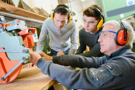laborers: Woodwork apprenticeship Stock Photo