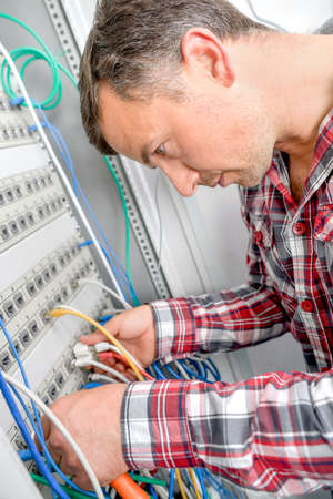 network cables: Repairing the server Stock Photo