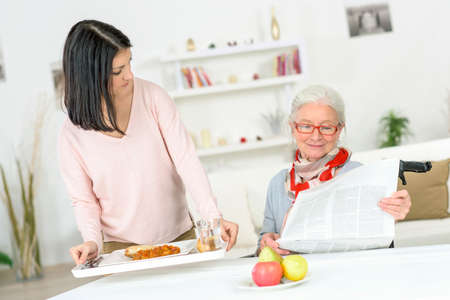 disabled seniors: Care worker Stock Photo