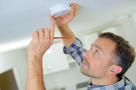 Smoke alarm installation Stock Photo