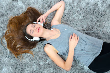 splayed: Woman listening to music