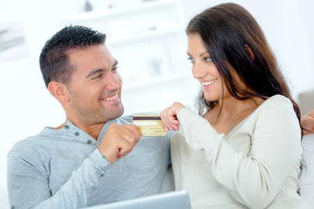 spending money: Spending money on-line Stock Photo