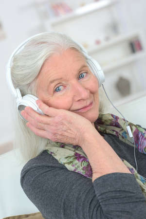 senior female: Senior lady wearing headphones