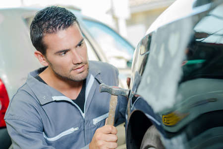 batidora: Panel Mecánico batiendo un coche Foto de archivo