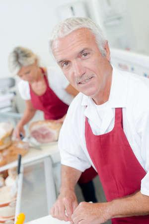 shop tender: Butcher serving a female customer