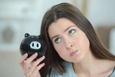 puffed cheeks: Lady with piggy bank