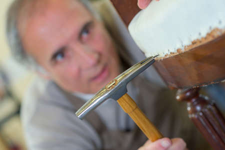 craft material: Repairing a chair Stock Photo