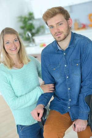 leg injury: Woman supporting her injured boyfriend Stock Photo