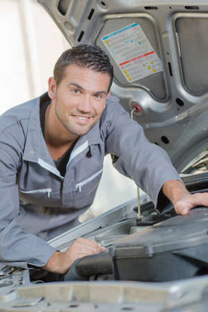 debug: Mechanic stood by a car