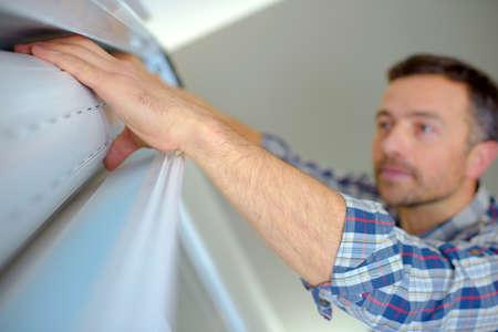 shutter: Handyman installing a window shutter