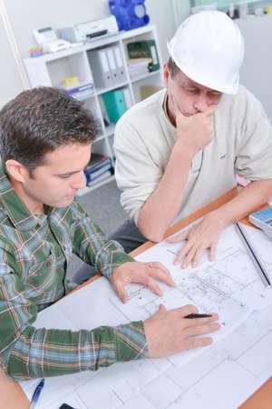 two men: Two men contemplating plans Stock Photo