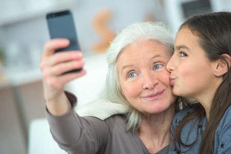 おばあちゃんと Selfie 写真素材