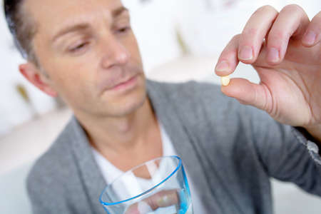take medicine: Man holding medication