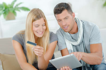 shop online: Couple using their tablet to shop on-line Stock Photo